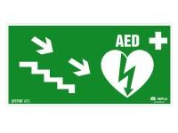 Znak AED w prawo schodami w dół