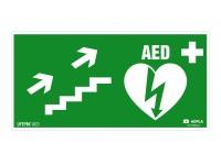 Znak AED w prawo schodami w górę